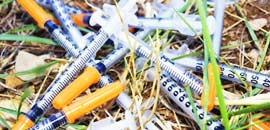 Needle and Syringe Clearance Clean Up and Removal Orange